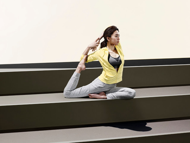 Yoga Instructor Waka Nozawa in a Women 's UV Cut long sleeve full zip hoodie, dry sweat pants, and comfort bra.